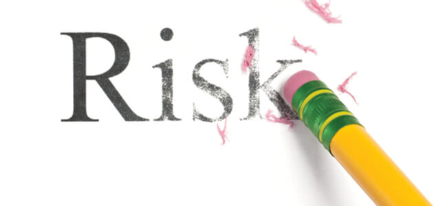 A yellow pencil erasing the word, 'Risk.'