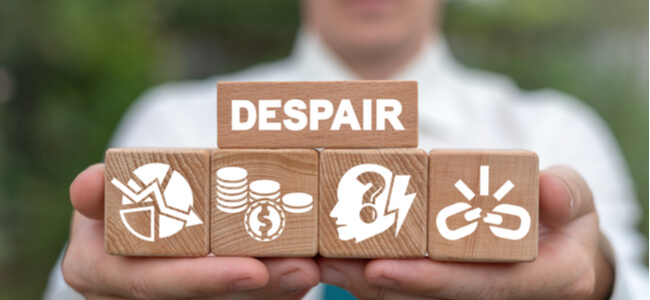 Despair Business Problem concept on wood blocks in businessman hands